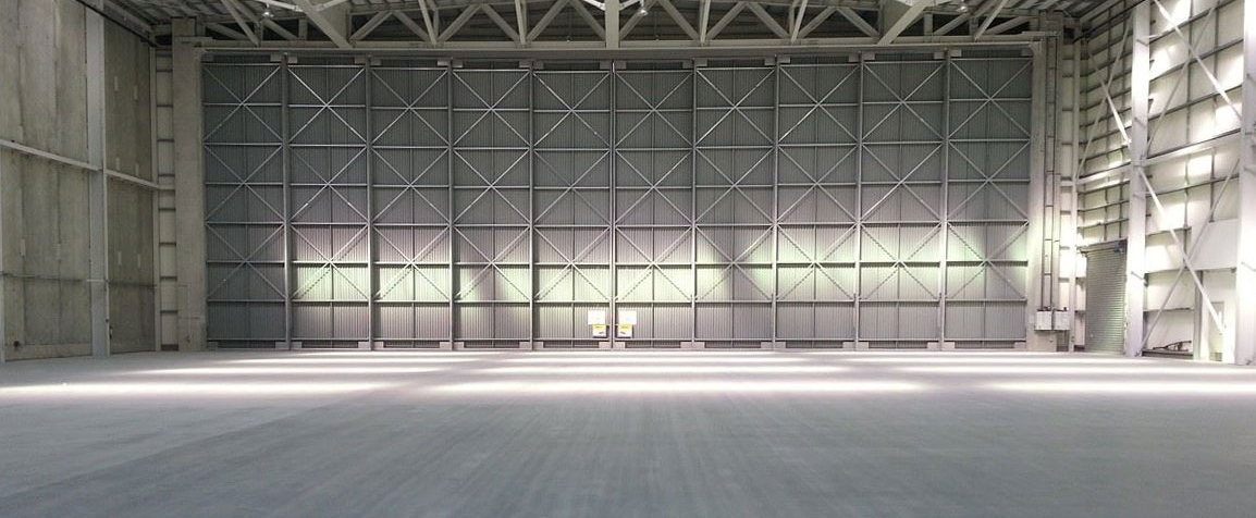 An interior shot of a large white warehouse